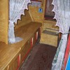 The cabin of the narrowboat Coronis. Listen to an audio dramatisation of the lives of the canal people.