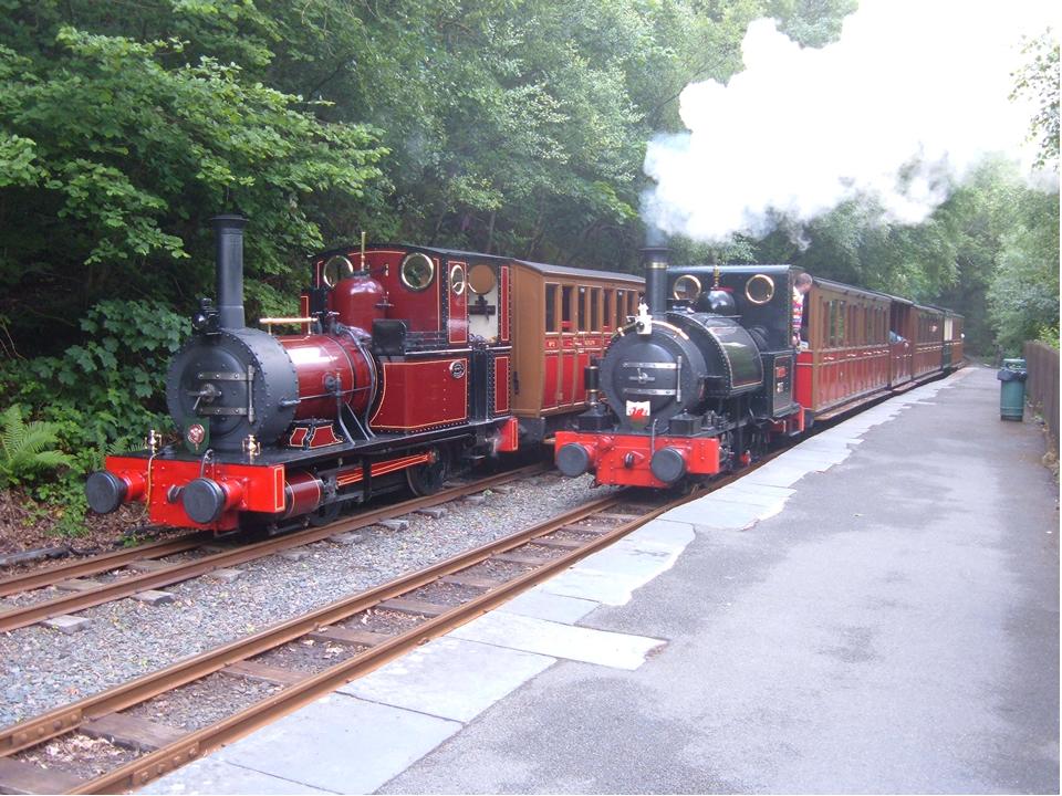 Original Talyllyn locomotives, No2 Dolgoch being passed by No1 Talyllyn at Abergynolwyn station.
