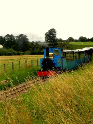 Bunty and coaches steam through the countryside.