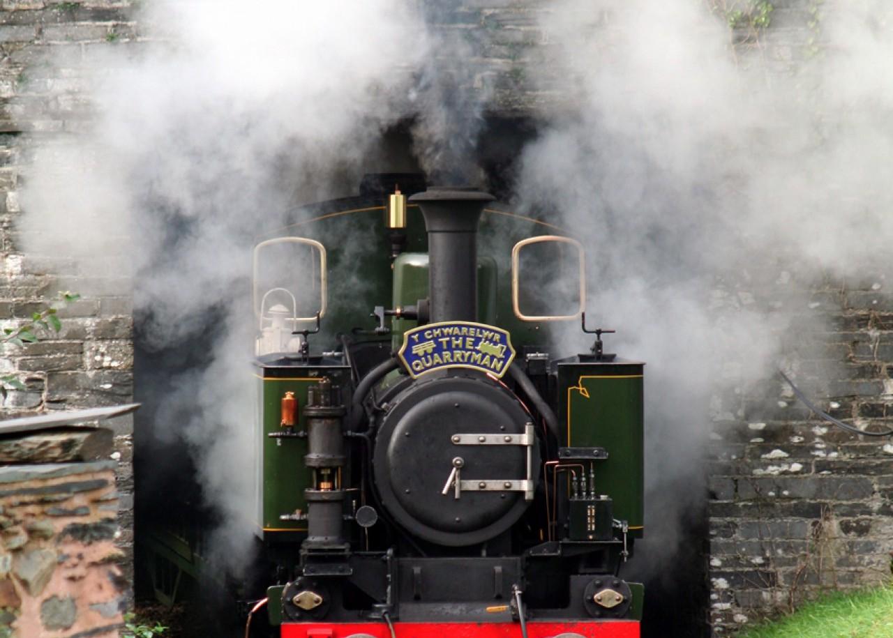 The newest Talyllyn locomotive No7 Tom Rolt burst through the station bridge at Rhydyronen.