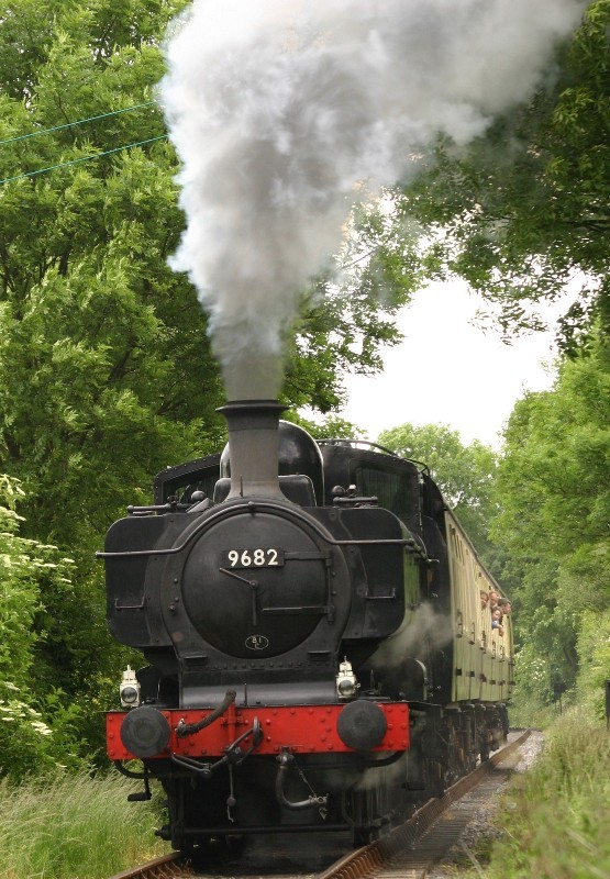 Pannier Tank No. 9682 in full steam on the Chinnor Railway
