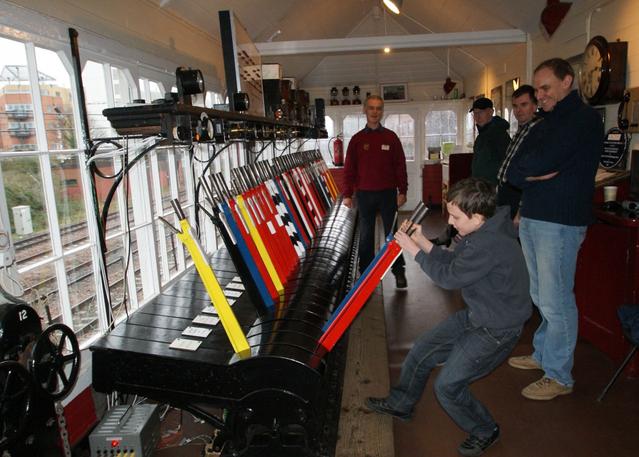 A young visitor has a go at being signalman