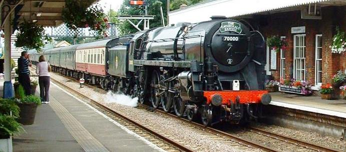 A main line steam-hauled excursion train passes Wymondham