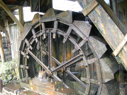 A waterwheel in action, this one powers the fan which blows air into the hearth, making the fire hot.