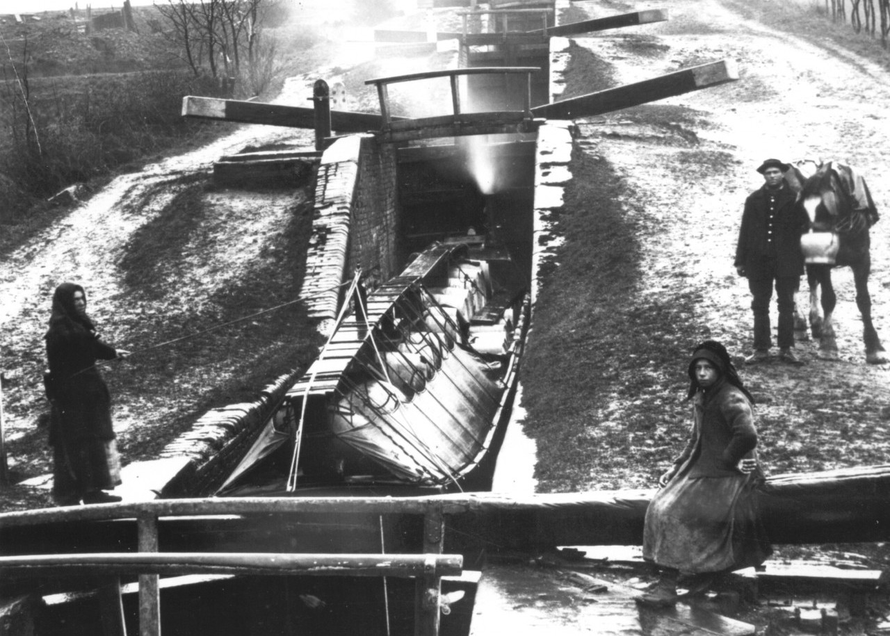 boats going down the locks in winter