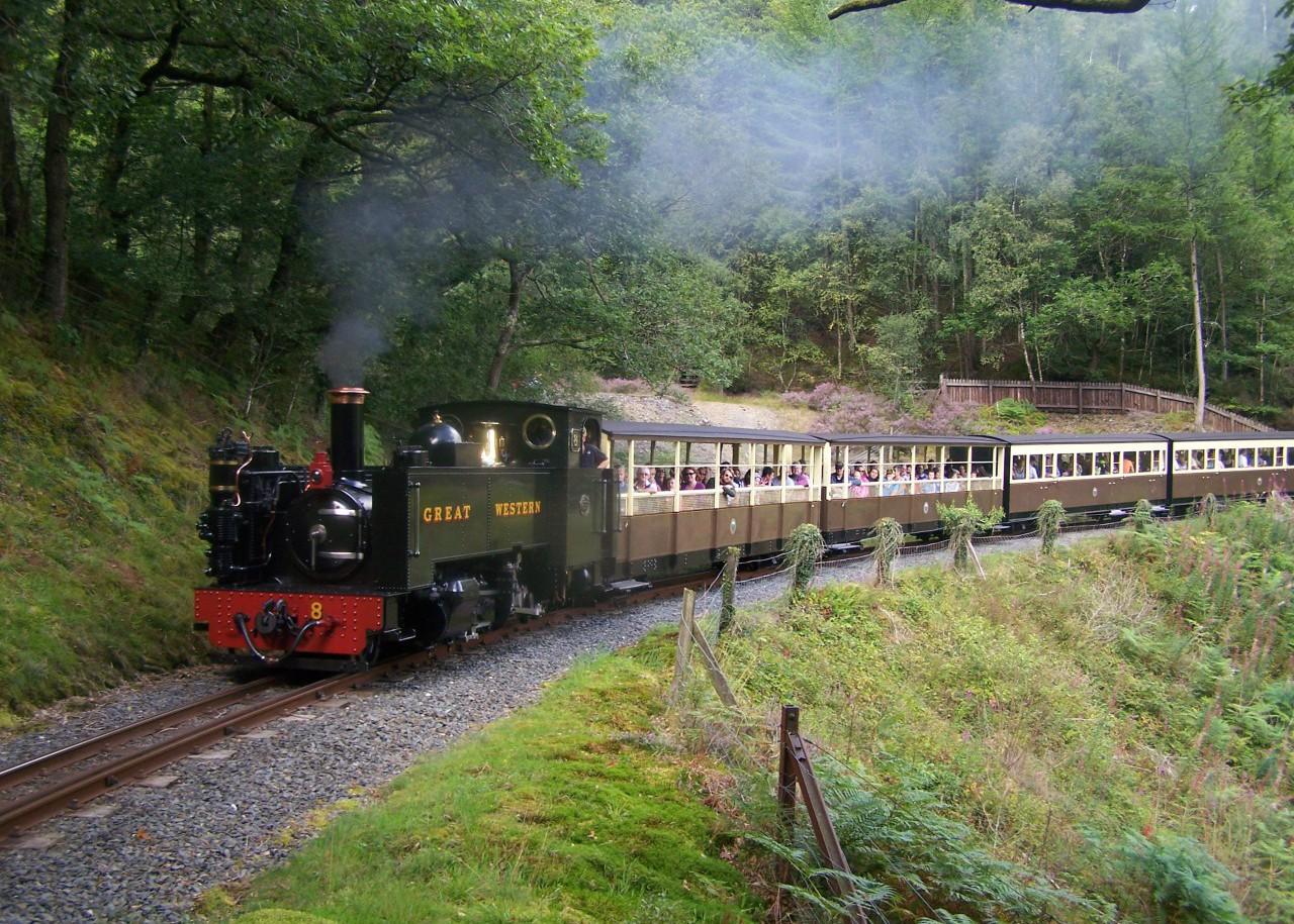 A busy train traverses the Horseshoe Bend