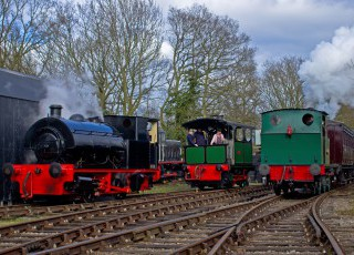 Bagnal_Works_No_2565_and_Cockerill_Tram_2525_pause_as_they_go_on_shed,_as_Wissington_runs_into_the_station_with_the_train_on_the_MSLR_during_the_Easter_Steam_up_event_on_6-4-15_Lawrie_Rose.jpg