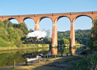 Under_the_viaduct_to_Whitby_-_John_Hunt.JPG